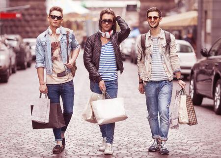 male fashion: Three Young male fashion metraseksualy shop shopping walk Stock Photo