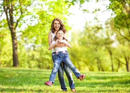 Mother and daughter enjoy the early spring. Mother day. Standard-Bild
