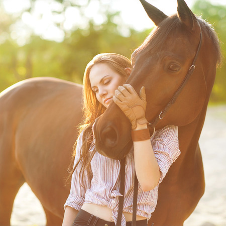 Beautiful woman and horse photo