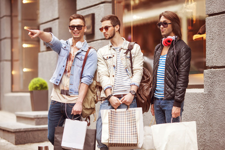 Three men fashion metraseksualy shop shopping walk photo