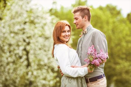 walk in: Couple in love walk near the riverr, smiling   Valentine Stock Photo