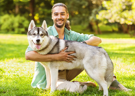 Man and Husky dog walk in the park Stock Photo - 30479748