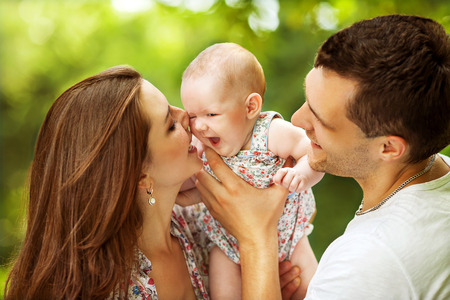 parents with baby in park Archivio Fotografico