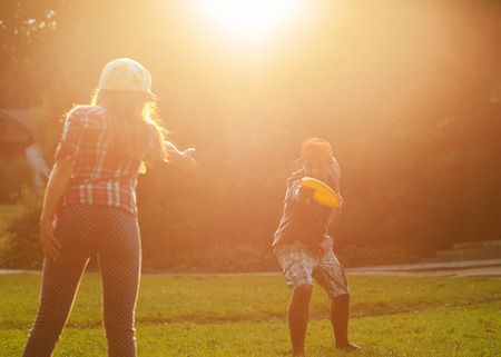 flying disc:  father and daughter spend a fun time at the park playing flying disc