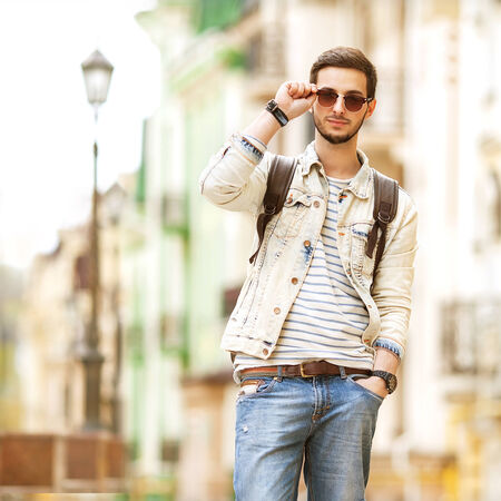 Portrait of attractive man with casual clothes walk in Europe