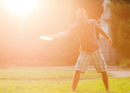 disc golf: man playing frisbee at its yard Stock Photo