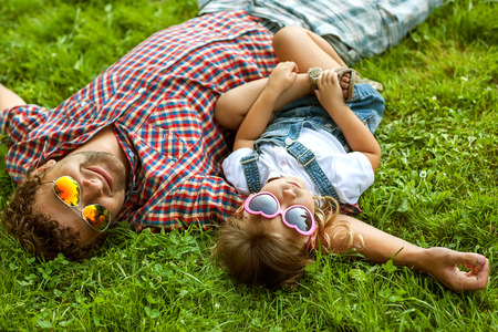 Father with daughter In Park smiling happy Foto de archivo