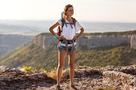 girl tourist in mountains photo