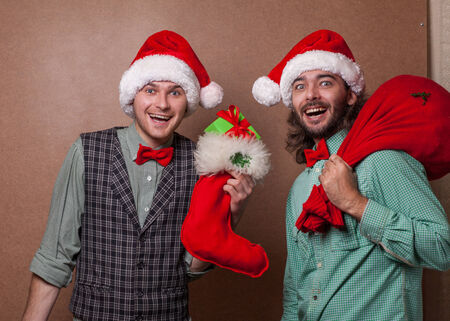 Two smiling Santa Claus in Christmas photo