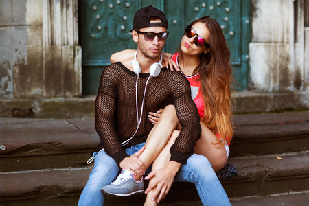 Close up portrait of happy smiling hipster couple in love. Wearing retro clothes and sunglasses. Fashion. Vogue. photo