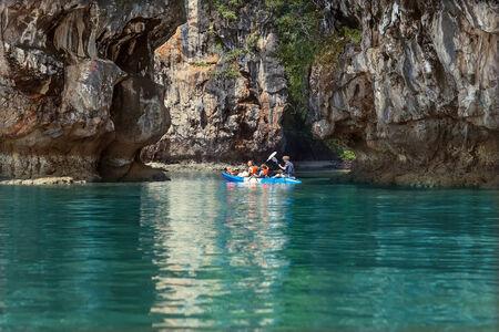 kayaker: family sailing kayaking among the rocks by the sea Stock Photo