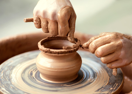 Hands working on pottery wheel Stock Photo - 37245600