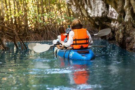 family kayaking through the jungle photo