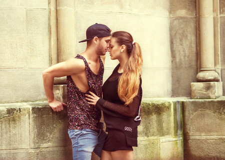 man standing: Fashion couple. VogueSexy and fashionable couple wearing jeans, sunglasses. Vogue