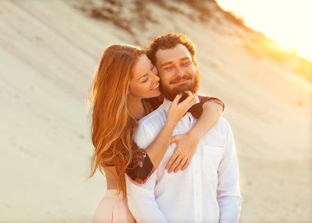happy couple in love on the sand dunes, Vietnam Stock Photo