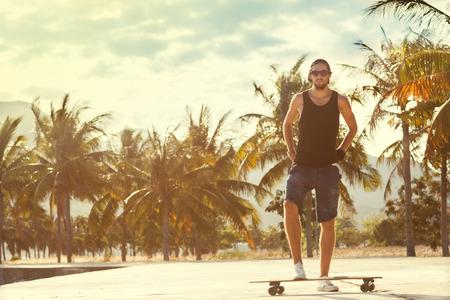 guy skateboard at sunset