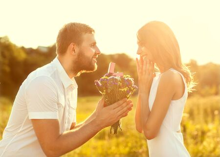 man doing on the nature engagement girl, surprise, emotion, sunset Stock Photo