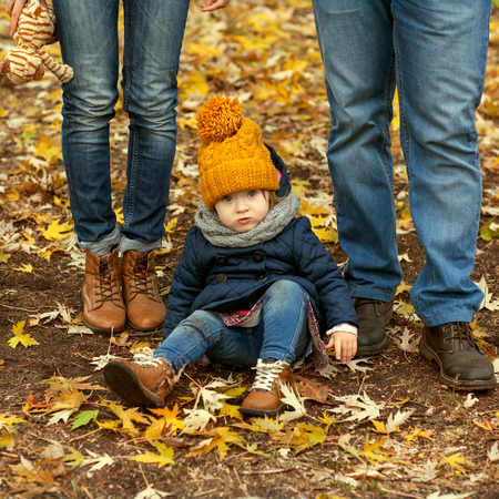 baby love: Family with a small daughter walk in autumn park Stock Photo