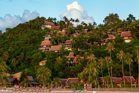Island Koh Phangan overlooks the hotels, palm trees and sunset