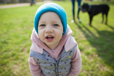 xwhite: Small rebenou makes selfie. Walking in the park on the green grass Stock Photo