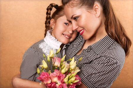 xwhite: Daughter in a studio, happy mothers day, giving her mother flowers in the studio, happy mothers day