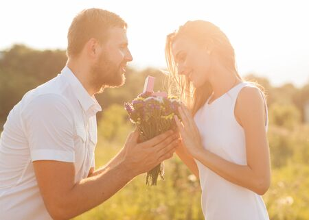xwhite: Guy gives a girl flowers, in love, romance, engagement concept