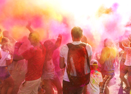 a crowd of people celebrating the Holi festival