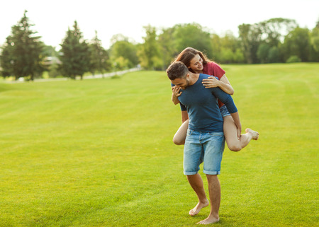 couple in love hugging in the park, concept of Valentine's Day