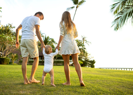 Family walk in the park, happy at sunset in Samui, Thailand Stock Photo