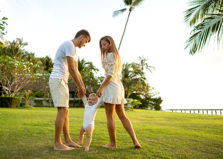 Family walk in the park, happy at sunset in Samui, Thailand
