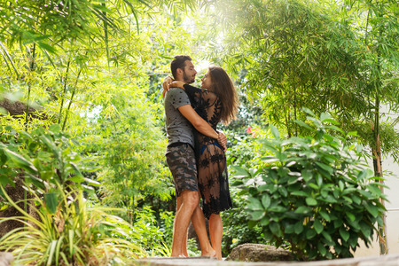 couple in love are standing at sunset in the jungle