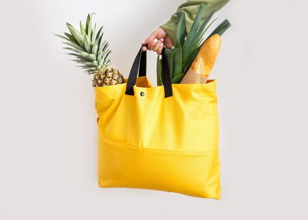 yellow  bag with products, delivery, takeaway Banco de Imagens