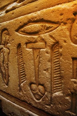 Egyptian hieroglyphics on the stone wall  photo