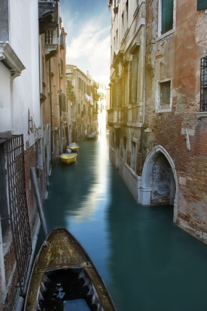 Narrow Canal and gondola, Venice, Italy  photo