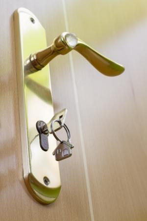 House keys in the door handle Stock Photo - 19377913