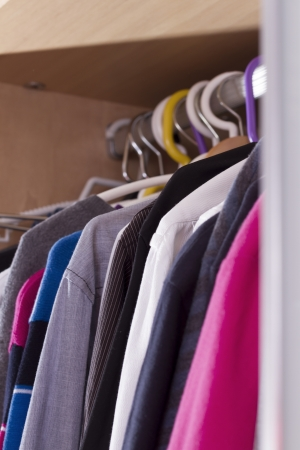 clotheshanger: Wardrobe colored clothes on hangers Stock Photo