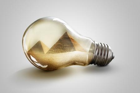 Great pyramids in Giza inside light bulb photo