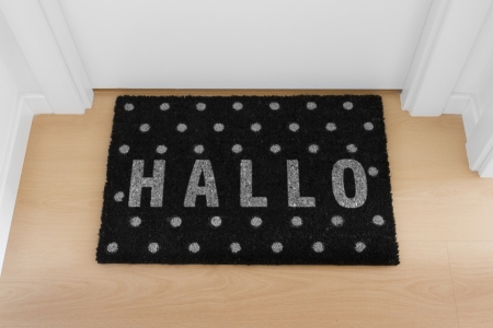 hallo: Welcome home black mat  Hallo Stock Photo