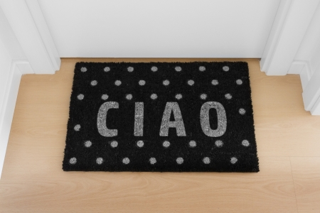 ciao: Welcome home black mat  Ciao Stock Photo