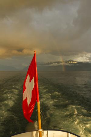 vevey: Rainbow  Swiss flag on boat  Lake Leman