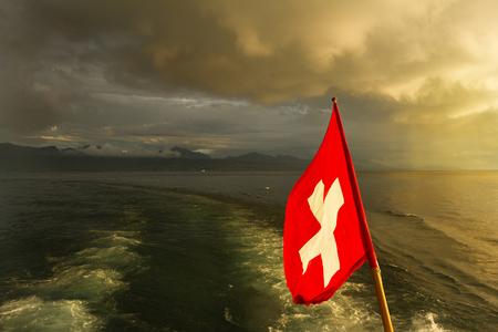 Switzerland  Swiss flag on boat  Lake Leman Stock Photo