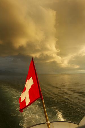 leman: Switzerland  Swiss flag on boat  Lake Leman Stock Photo