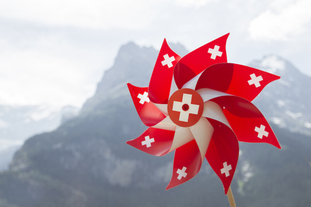 Swiss pinwheel  With mountains in the background Stock Photo - 22994176