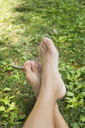 Male feet lifted on green background
