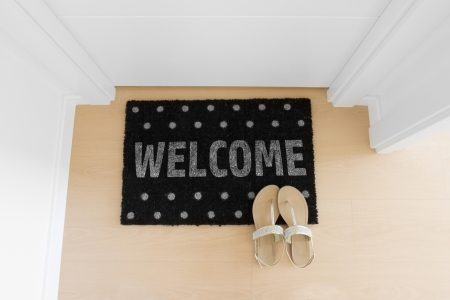 Welcome home doormat with closed door