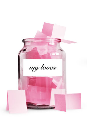 loves: Loves written on paper in glass jar, isolated on white