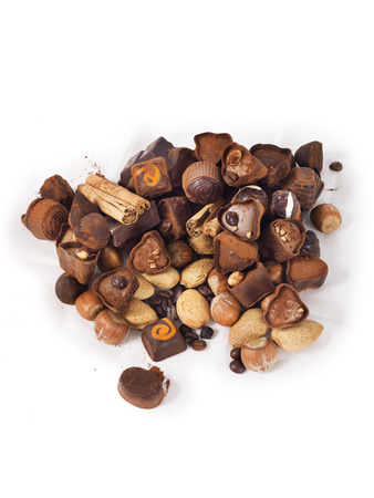Delicious chocolates on a white background photo
