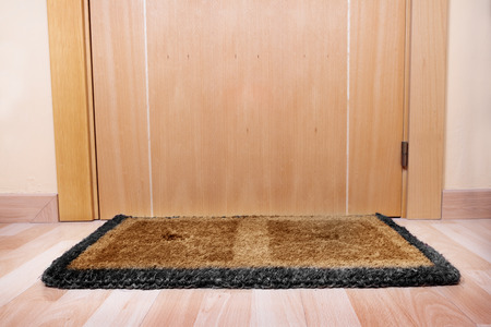 welcome mat: Welcome home on brown mat