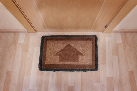 welcome mat: Welcome home on brown mat with arrow
