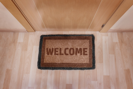 entrance: Welcome home on brown mat